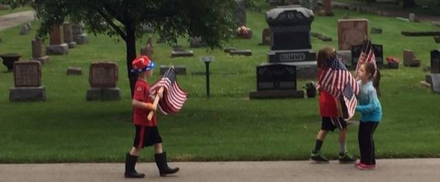 Children Placing American Flags in Cemetery