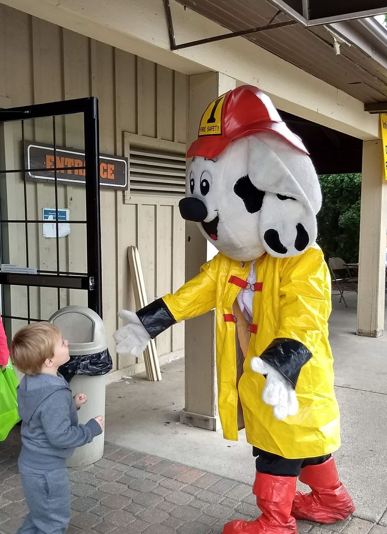 Sparky the Fire Dog interacting with children
