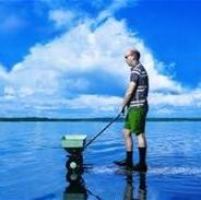 Man with Lawn Spreader in Lake_thumb_thumb.jpg